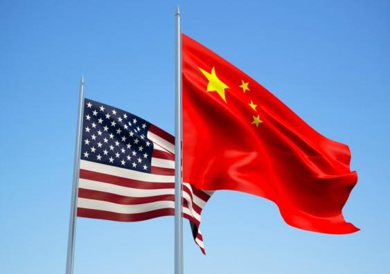 US and and China flags waving in the wind